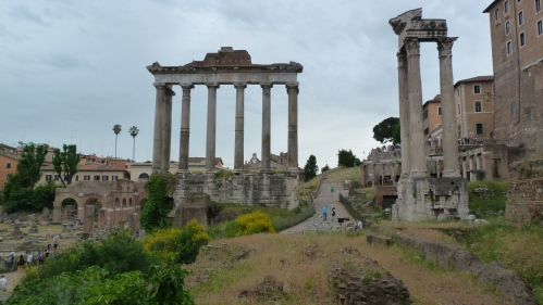 The Temple of Saturn (Left) and the three columns of the Temple of Vespasian (Right)